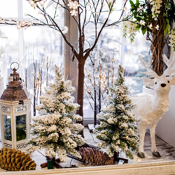 Christmas scene with burning candle and christmas decorations on winter windowsill