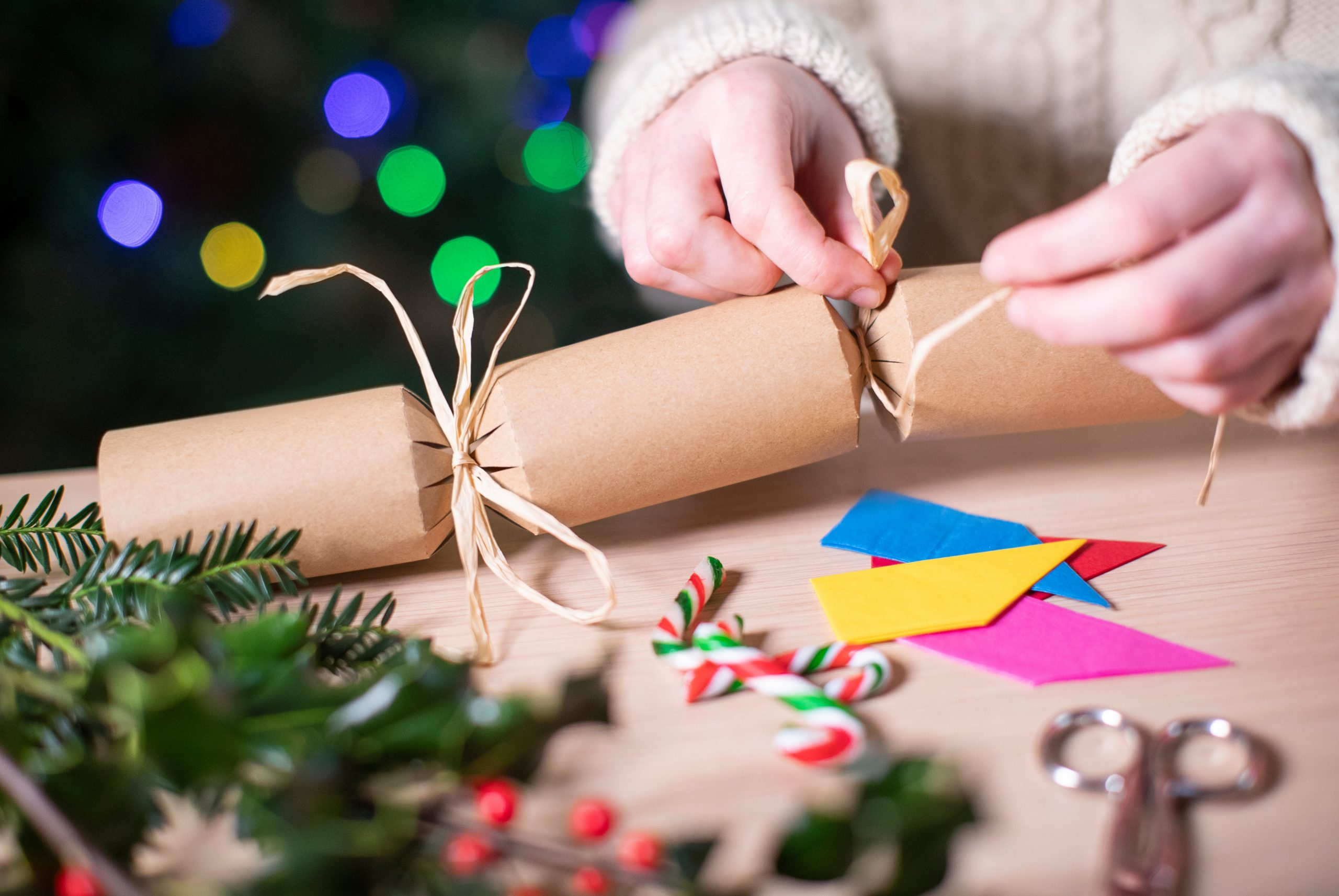 Close Up Of Woman Making Homemade Eco Friendly Christmas Cracker From Sustainable Materials