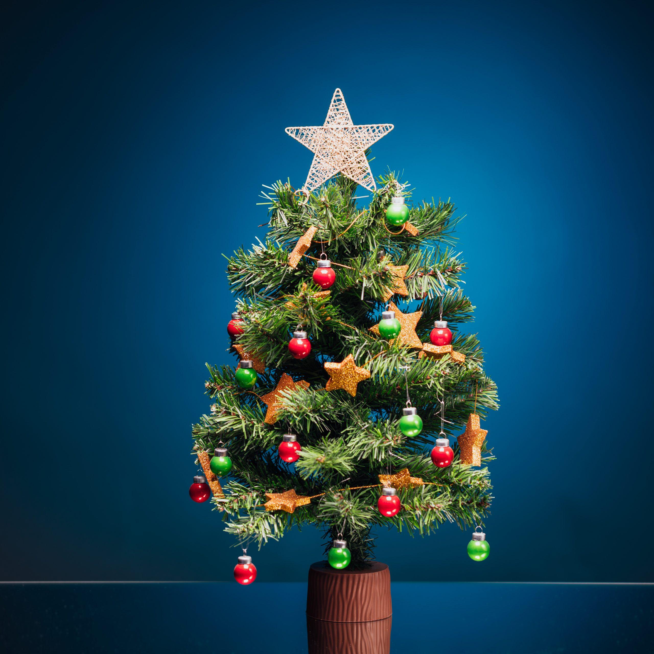 festive Christmas tree on blue background